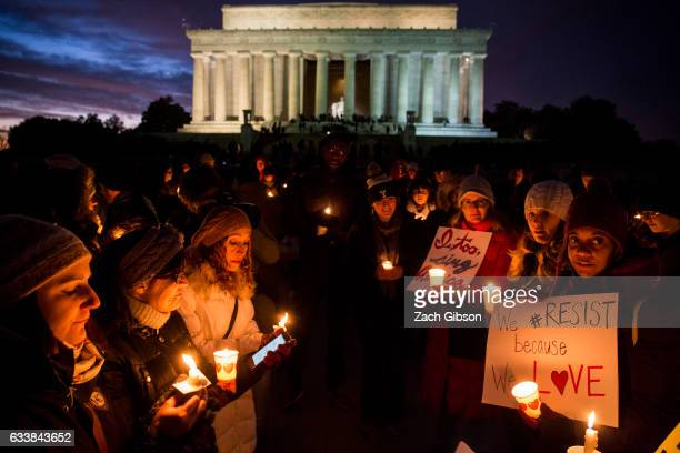People hold candles during a vigil in front of the Lincoln Memorial on February 4 2017 in Washington DC The vigil was held in solidarity with...