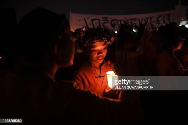 TOPSHOT People hold candles during the celebrations for Thai King Maha Vajiralongkorns 67th birthday in Bangkok on July 28 2019
