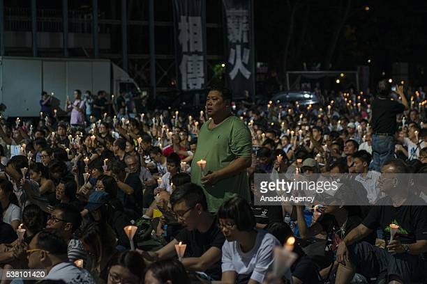 People hold candles during the commemoration of the Tiananmen Square victims at a vigil in Hong Kong on June 4 2016 Thousands of people in Hong Kong...