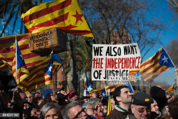 People hold Catalan proindependence 'estelada' flags and placards outside the TSJC in Barcelona on February 6 2017 during the first day of the trial...