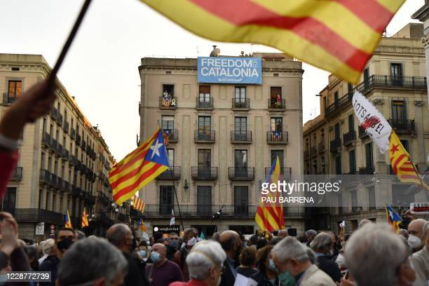 People hold Catalan pro-independence Estelada flags during a demonstration organized by the Catalan National Assembly and Omnium Cultural, the two...