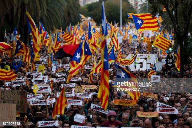 People hold Catalan proindependence Estelada flags during a demonstration in Barcelona on November 11 2017 calling for the release of jailed...