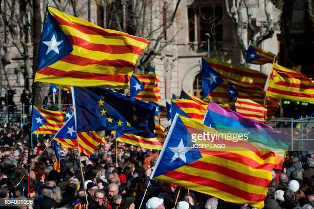 People hold Catalan proindependence 'estelada' flags outside the TSJC in Barcelona on February 6 2017 during the first day of the trial of former...