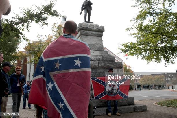 People hold Confederate flags during a White Lives Matter rally on October 28 2017 in Murfreesboro Tennessee Tennessee Gov Bill Haslam said state and...