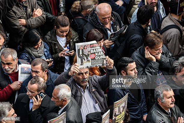 People hold Cumhuriyet Daily newspapers in front of the media headquarters on November 27 2015 in Istanbul during a demonstration after the arrest of...