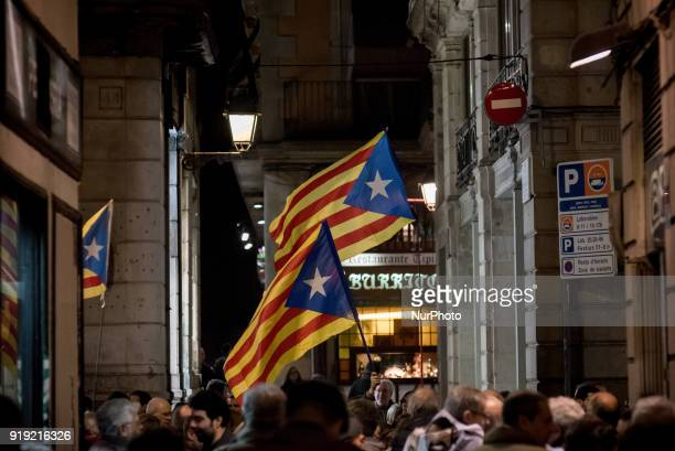 People hold estelades or proindependence flags during a march in support of imprisoned Catalan leaders in Barcelona Catalonia Spain on 16 February...