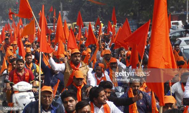 People hold flags and raise slogans during a rally to mark the 26th anniversary of Babri Masjid demolition on December 6 2018 in Gurugram India