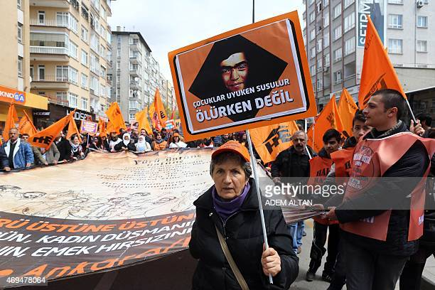 People hold flags and signs during a protest against Turkey's ruling Justice and Development Party in Ankara on April 12 2015 AFP PHOTO / ADEM ALTAN