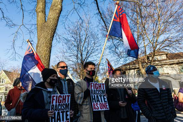 """People hold flags of the Karen National Union during the """"Asian Solidarity March"""" rally against anti-Asian hate in response to recent anti-Asian..."""