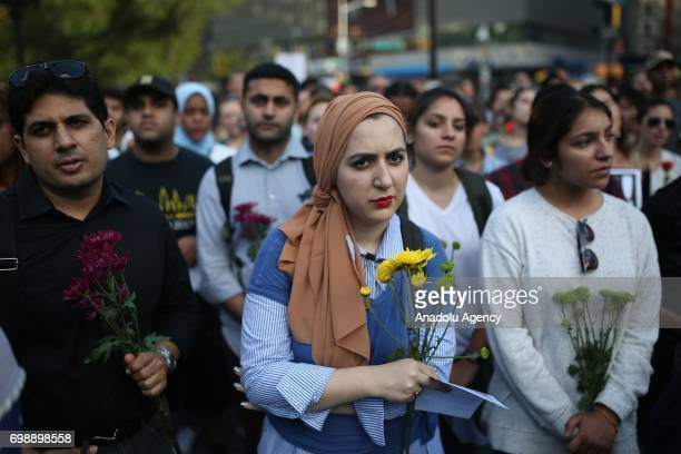 People hold flowers during a vigil in Union Square of Manhattan borough of New York United States on June 20 for Nabra Hassanen a 17yearold Muslim...