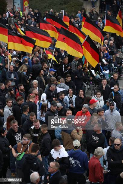 People hold German flags as they take part in a march of silence organized by the rightwing Alternative for Germany political party on September 1...