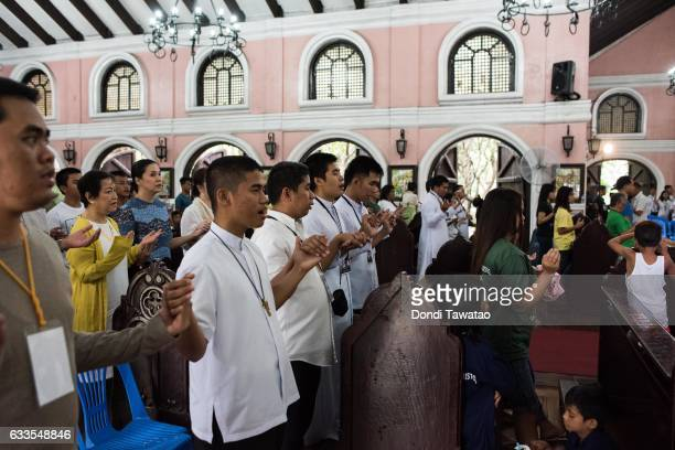 People hold hands in prayer during a mass held for victims of the drug war on February 2 2017 in Manila Philippines Philippine president Rodrigo...
