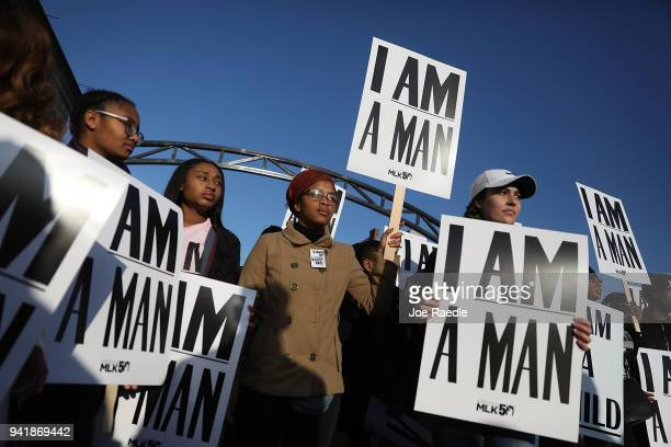 People hold 'I Am A Man' signs in reference to the sanitation workers strike in 1968 as they participate in an event to mark the 50th anniversary of...