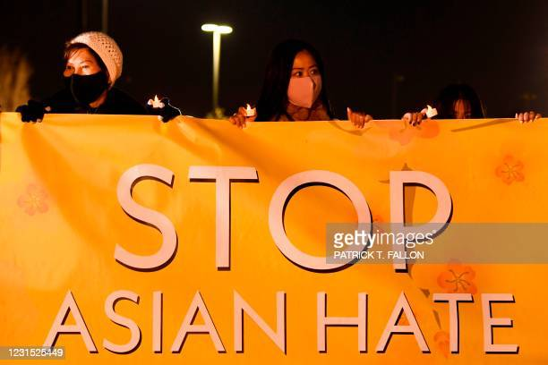 "People hold lights during a vigil organized by Nailing It For America for those who have died from Covid-19 and to ""Stop Asian Hate"" on March 4, 2021..."