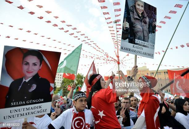People hold martyrs' portraits as they attend July 15 Democracy and National Unity Day's events to mark July 15 defeated coup's 1st anniversary in...