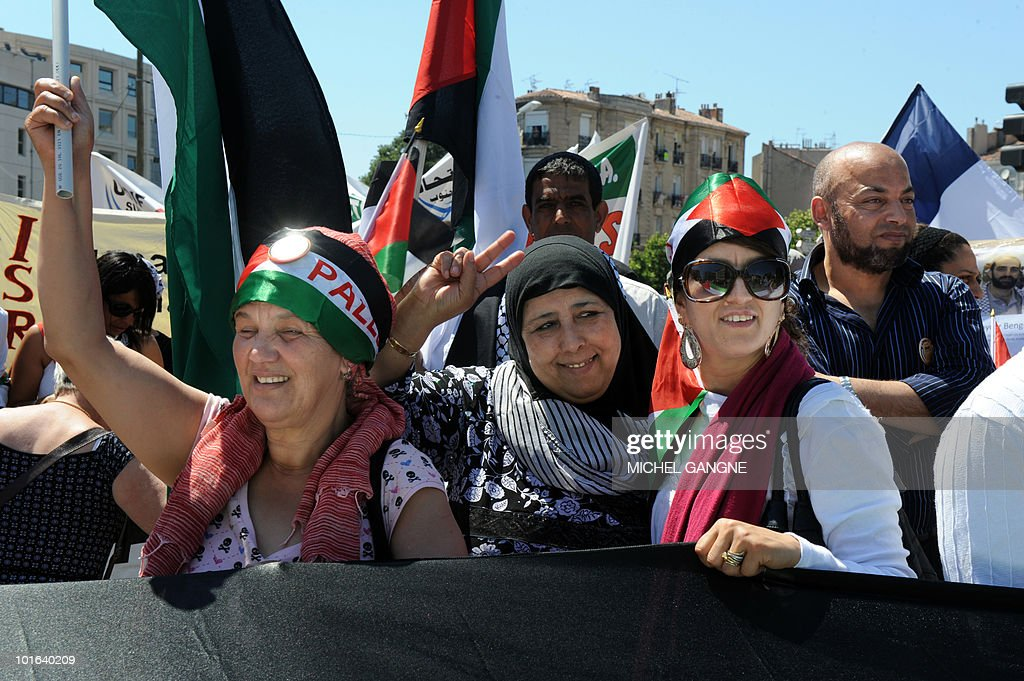 People hold palestinian flags on June 5, 2010 in Marseille, southern France, during a demonstration to protest Israel's storming of a Gaza-bound aid flotilla that left nine pro-Palestinian activists dead, as another ship was expected to try to break the Israeli blockade of Gaza..