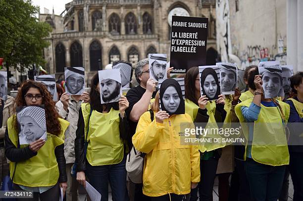 People hold pictures of Samar Badawi and her brotherb jailed Saudi blogger Raif Badawi as they demonstrate in support of Raif Badawi who was...