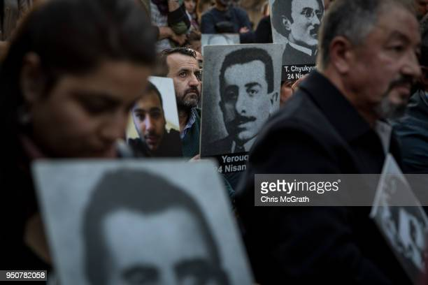 People hold pictures of victims during a memorial to commemorate the 1915 Armenian mass killings on April 24 2018 in Istanbul Turkey People gathered...