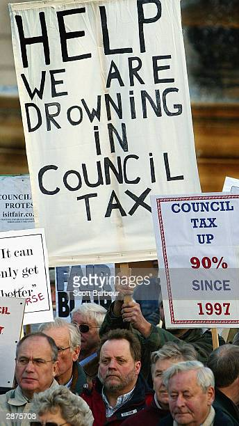 People hold placards aloft during the first national demonstration against rising council tax bills on January 17 2004 in London England The protest...