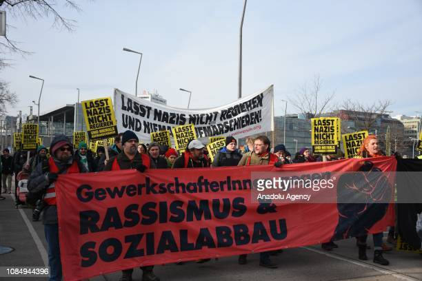 People hold placards and banner during a protest against policies of Freedom Party of Austria rightwing populist and nationalconservative political...