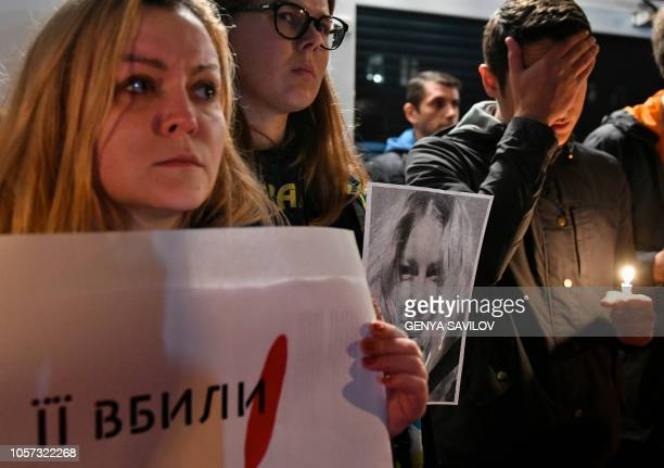 People hold placards and portraits of Gandzyuk in front of the Ministry of Internal Affairs of Ukraine in remembrance of Ukrainian anticorruption...