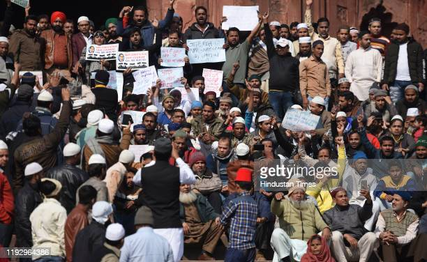 People hold placards and raise slogans during a protest against Citizenship Amendment Act National Population Register National Register of Citizens...