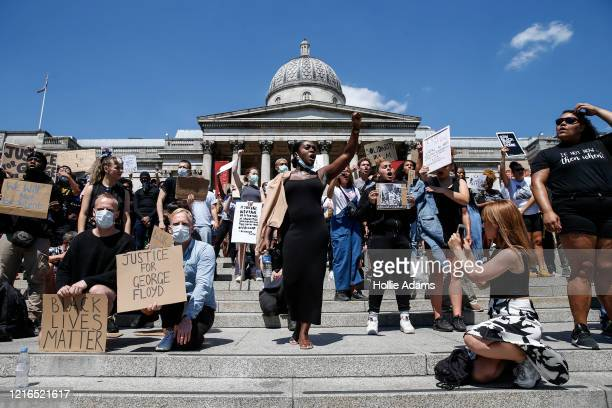 People hold placards as they join a spontaneous Black Lives Matter march at Trafalgar Square to protest the death of George Floyd in Minneapolis and...
