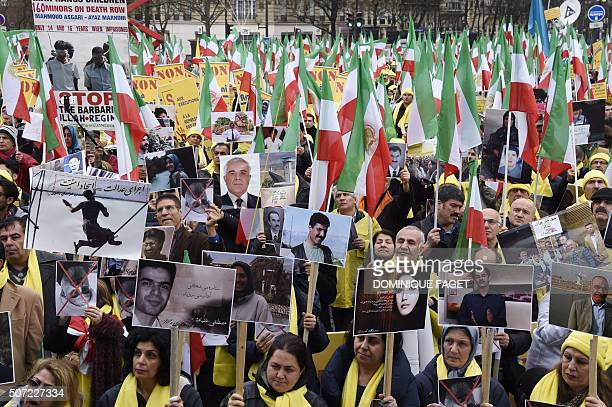 TOPSHOT People hold placards displaying portraits during a demonstration against Iran's President visit to France on January 28 2016 Iranian...