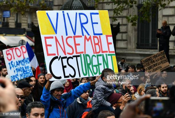People hold placards during a demonstration to protest against Islamophobia, near the Gare du Nord in Paris, France on November 10, 2019.