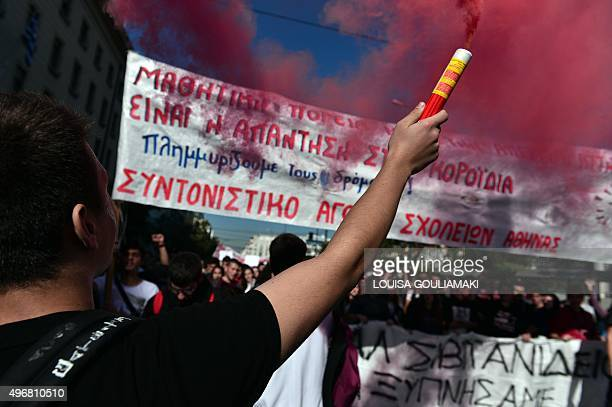 People hold placards during a massive demonstration as part of a 24hour general strike in Athens on November 12 2015 Around 20000 people demonstrated...