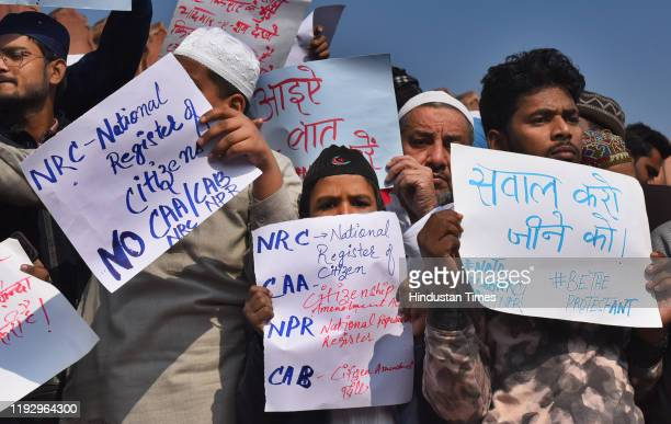 People hold placards during a protest against Citizenship Amendment Act National Population Register National Register of Citizens and attacks on...