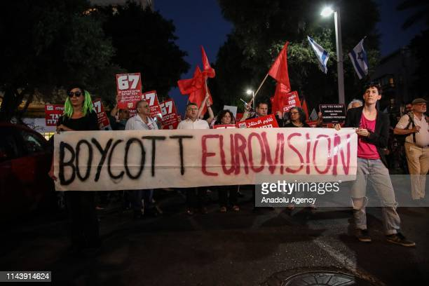 People hold placards during a protest against Eurovision Song Contest demanding the removal of continuing Israel's blockade on Gaza at Habima Square...
