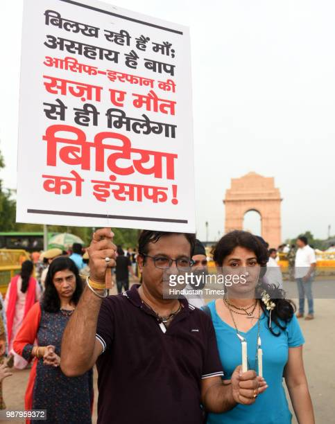 People hold placards during a protest against the brutal rape of a sevenyearold girl in Mandsaur Madhya Pradesh at India Gate on June 30 2018 in New...