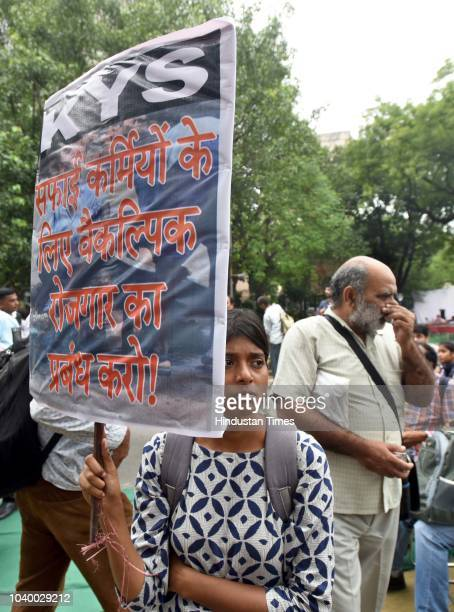 People hold placards during a protest against the violation of Manual Scavenging Prohibition Act 2013 at Jantar Mantar on September 25 2018 in New...