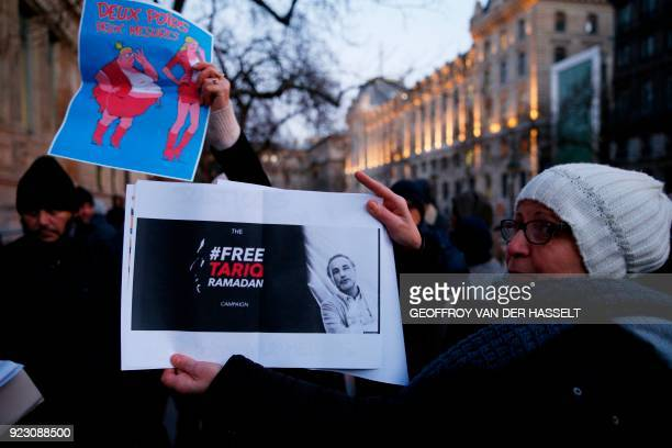 People hold placards including one reading 'Two weights two mesures' during a gathering in support of Islamic scholar Tariq Ramadan who is detained...