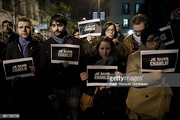 People hold placards reading 'Je Suis Charli' during a gathering of people showing their support for the victims of the terrorist attack at French...