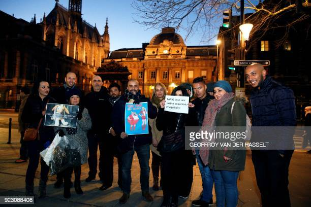 People hold placards reading 'Presumption of innocence until proof of the contrary' 'Two weights two mesures' and 'Tariq for an impartial and...