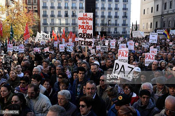 """People hold placards reading """"Peace"""" during a demonstration against terrorism, anti-Muslim sentiment and war organized by the collective..."""