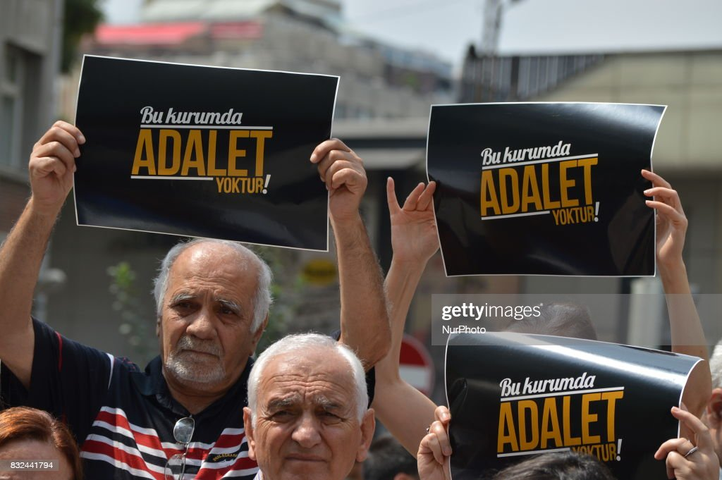 People hold placards that read 'There is no justice in this council' as anti-government demonstrators gathered in front of the Supreme Election Council (YSK) to protest against unsealed ballot papers in the voting for the Turkish constitutional referendum in Ankara, Turkey on August 16, 2017. The referendum was held on April 16 as the demonstrators chant the slogan 'We still search for justice' in the fourth month after historic voting.