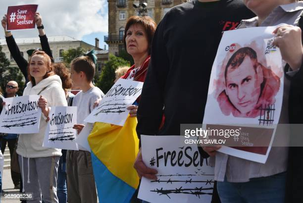 People hold placards with an appeal to free Ukrainian film director Oleg Sentsov during a rally in Kiev on July 1 to demand the release Oleg Sentsov...