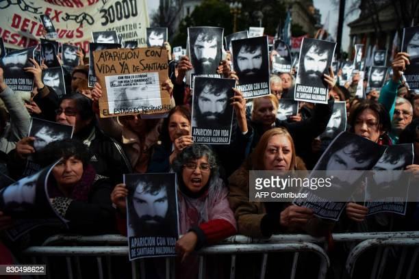 People hold portraits of activist Santiago Maldonado disappeared on August 1st during a Mapuche protest in Chubut province during a demonstration...