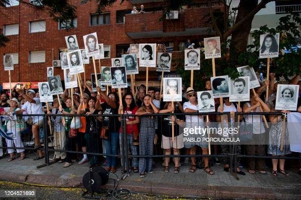 People hold portraits of the Disappeared during Uruguay's civicmilitary dictatorship as the motorcade of newly sworn President Luis Lacalle Pou...
