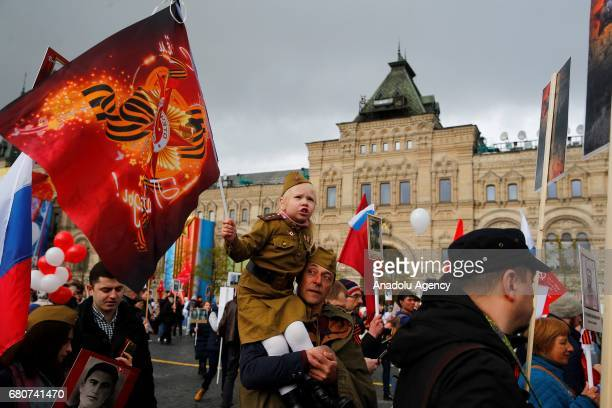 People hold portraits of their relatives who fought in World War II during the Immortal Regiment march in Moscow on the day of the 72th anniversary...