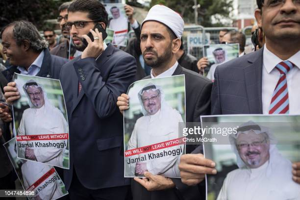 People hold posters of Saudi journalist Jamal Khashoggi during a protest organized by members of the TurkishArabic Media Association at the entrance...