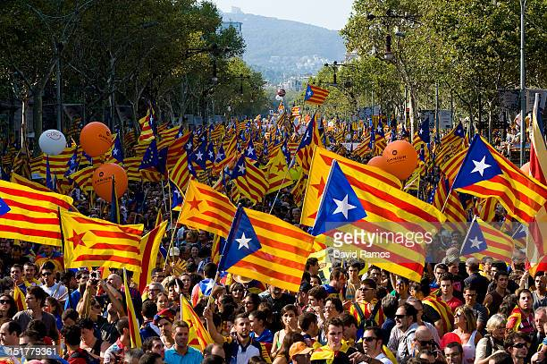 People hold Proindependence Catalan flags in a demonstration calling for independence during the Catalonia's National Day on September 11 2012 in...