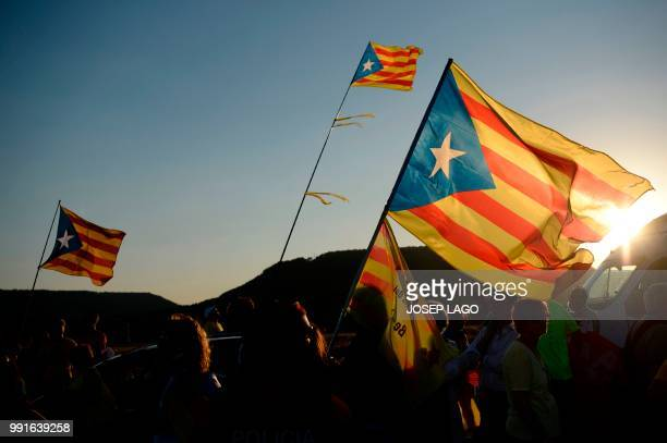 People hold proindependence Estelada flags during a demonstration outside the Lledoners jail in Sant Joan de Vilatorrada 50 kms from Barcelona on...