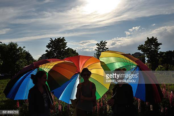 People hold raibow umbrellas to celebrate International Day Against Homophobia in front of the Romanian Parliament building in Bucharest May 17,...
