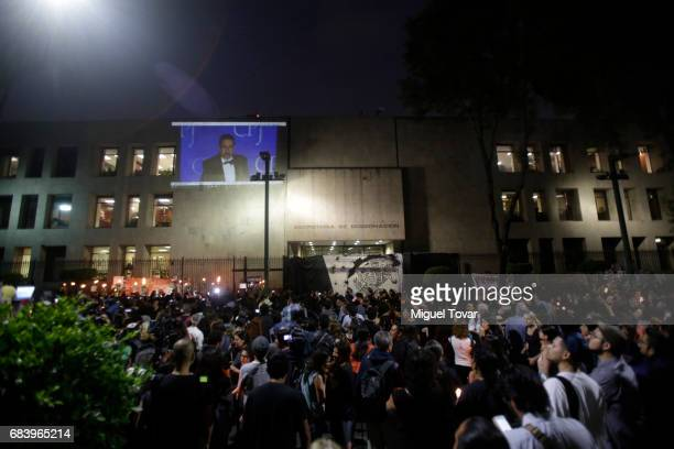 People hold signs and candles during a demonstration after the Mexican journalist Javier Valdez murder at Secretary's of Interior on May 16 2017 in...