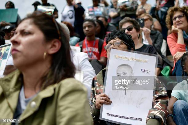 People hold signs and portraits of victims at an anti gun violence rally on the Art Museum steps in Philadelphia PA on June 11 2018 The 3rd annual...