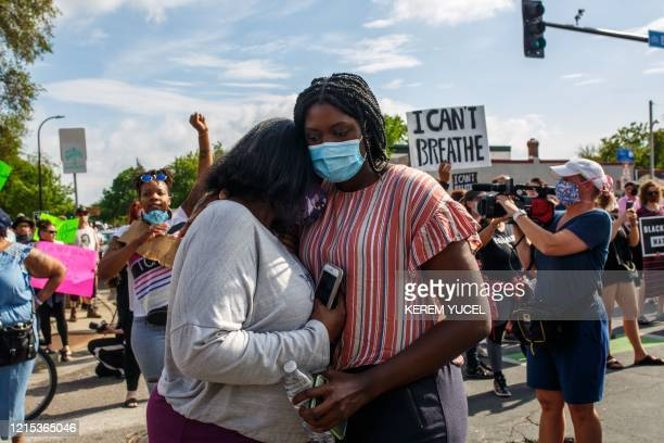 People hold signs and protest during a rally after a Minneapolis Police Department officer allegedly killed George Floyd on May 26 2020 in...